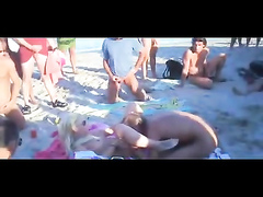 Blowbang and copulating at the nude beach