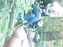 Smoking girls watch him masturbate in the woods