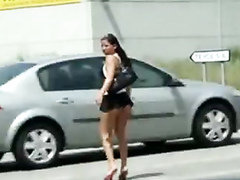 Shameless girl walks down the street in a micro skirt