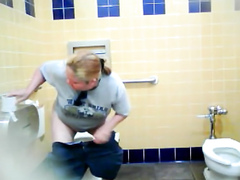 Chubby blonde uses the public toilet