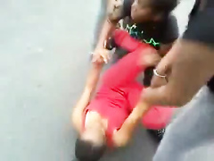 Black maids throwing punches in the street