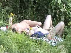 Cute couple enjoys hot sex on a picnic