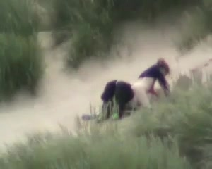 Voyeur sex in the dunes on a breezy day
