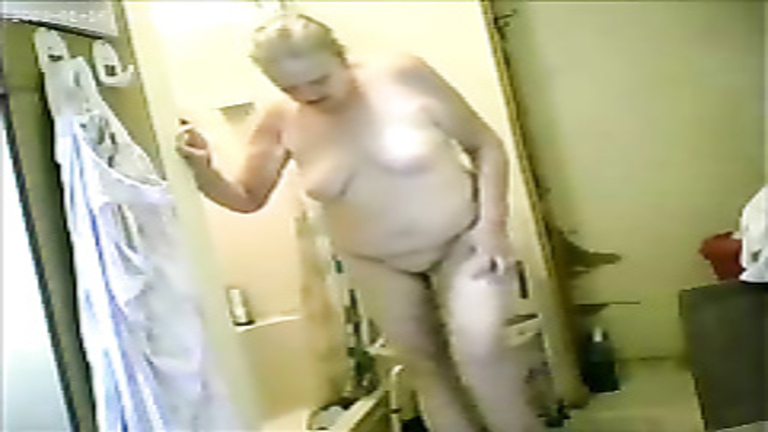 Granny dries her body after a shower