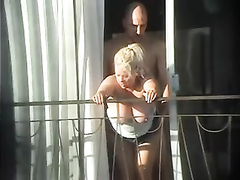 German tourists have fun on the balcony