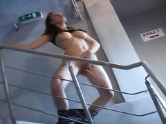 Busty babe takes a huge piss in the stairwell
