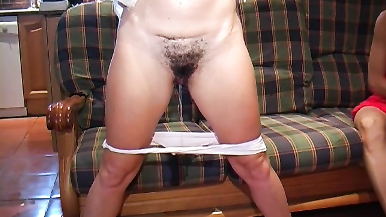 My girlfriend with a bush pissing in our living room