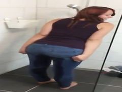 Cute ginger chick pisses her jeans and soaks them