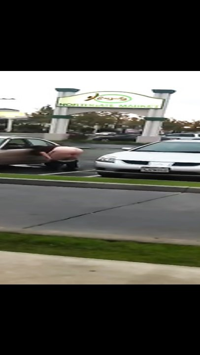 Fat woman urinates in a public parking lot