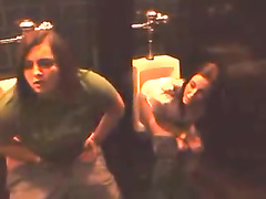 Bar girls pee in the urinals