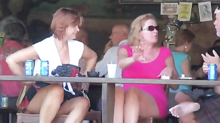 Charming ladies on the deck of a bar