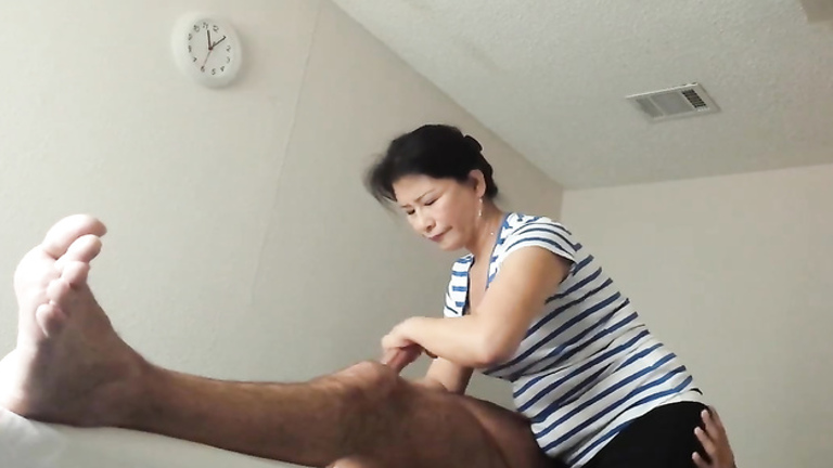 Mature thai handjob
