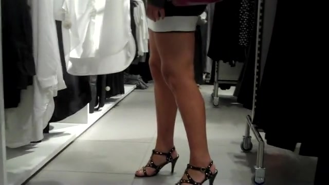 Curvy woman in a short skirt goes shopping