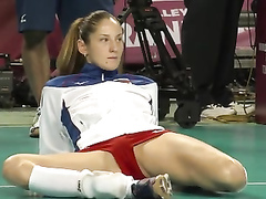 Leggy volleyball girl stretches before a match