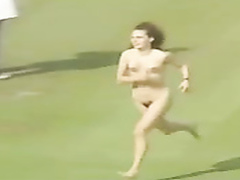 Female streaker runs across the stadium