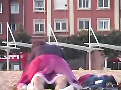Rubbing the pussy on boyfriend's cock on the public beach