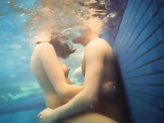 Sexually excited tourists having the underwater sex