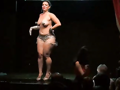 Chubby lady dances naked in the theatre