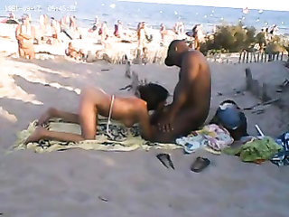 Ebony couple has an outdoor blowjob action
