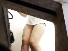 Fitting room camera films undressed women