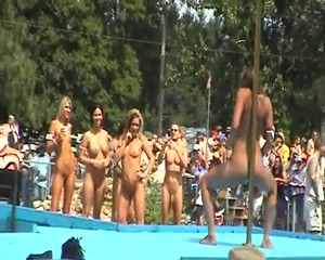 Strippers work the stage at an outdoor party