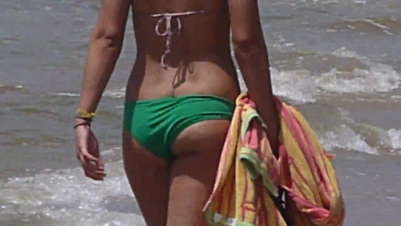 Tanned woman with a nice butt at the beach