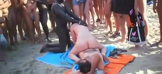 Beach girl rides dick and sucks another for a crowd