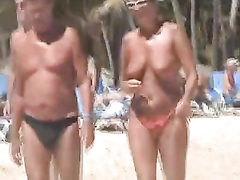 Topless women need ogling at the public beach