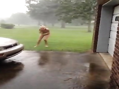 Naked girlfriend runs outdoors in a hurricane