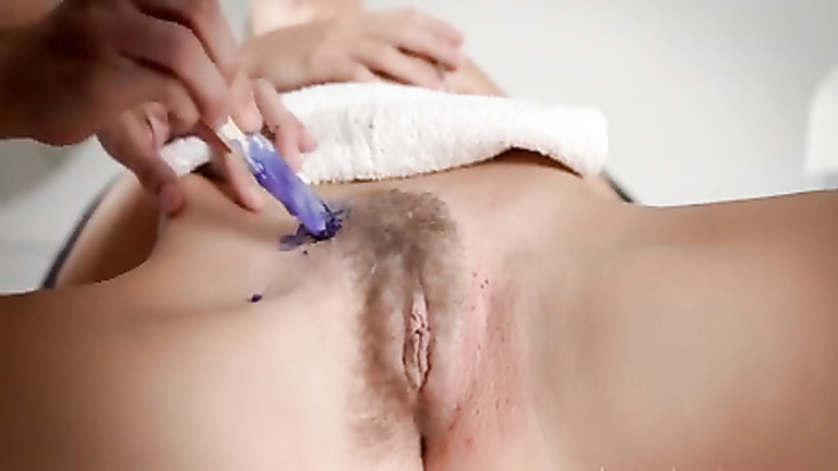 Delicate waxing of a beautiful pussy