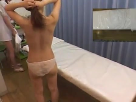 Slender Asian girl gets a lovely massage