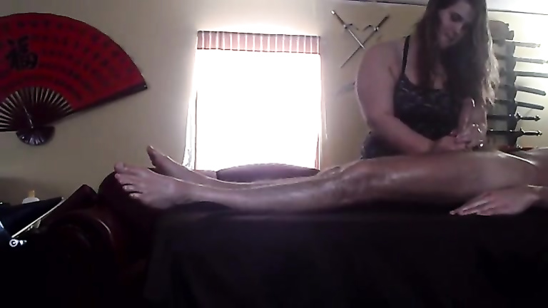Fat masseuse gives a blowjob to her male client