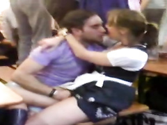 Dude tickles his girlfriend at Oktoberfest