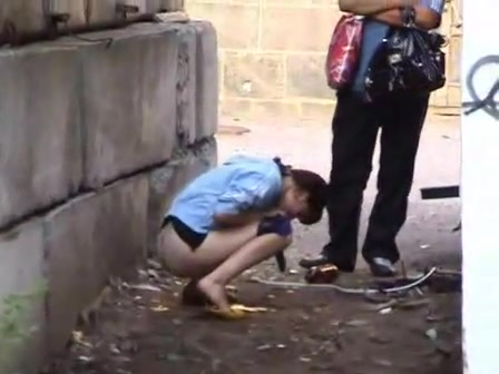 Cutie pissing in an alley as her man waits