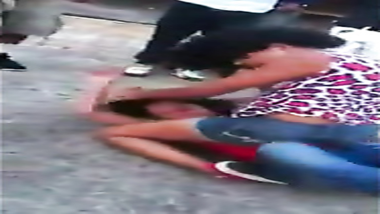 Female street fight with hard punches and hair pulling