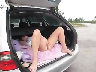 Wife flashes her pussy in the trunk of the car