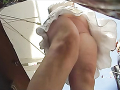 Shaved pussy upskirt at the flea market