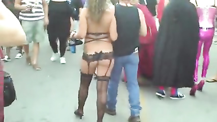 Busty ladies expose their jugs to the crowd