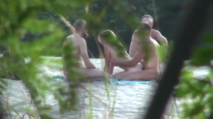 Russian nudists make love in a grassy field