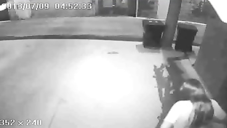 Her long piss is caught on security cam