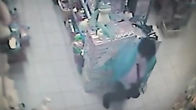 Woman pees on the floor in a store