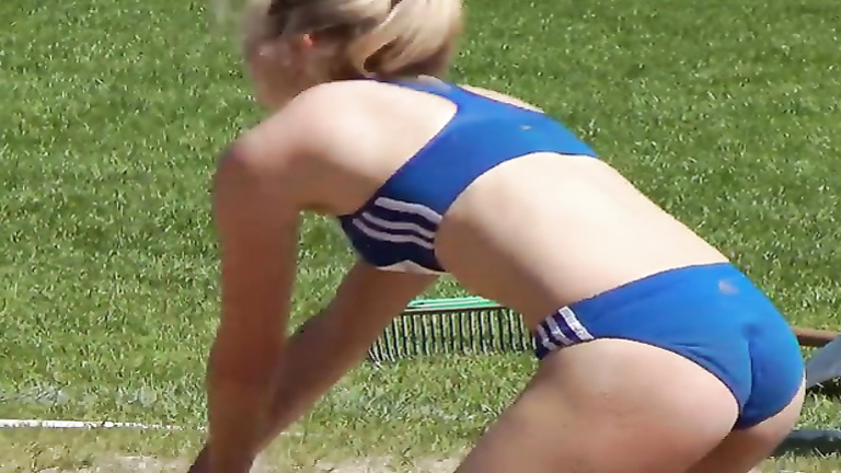 Scantily clad long jumper has a nice ass