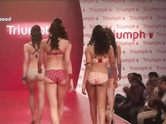 Four babes in lingerie walk the runway