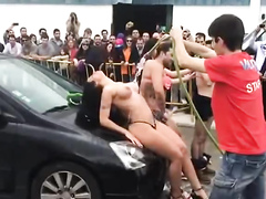 Soaking sexy big boobs at a car wash