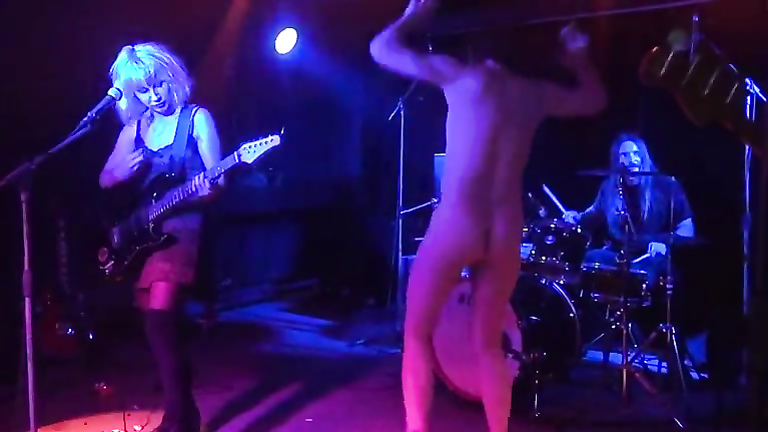 Drunken man gets naked on the rock stage
