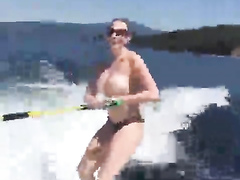 Topless chick in the water skiing adventure
