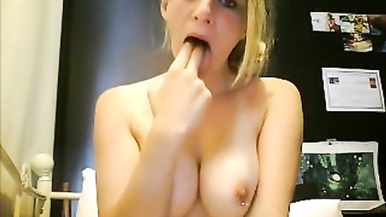 Lovely flasher with nipple rings plays with her spit