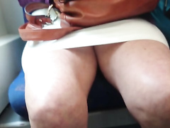 Thick thighs chick in a tight skirt on the train