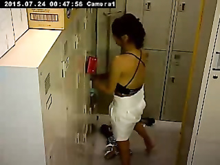 Cute Asian girl changes in the locker room