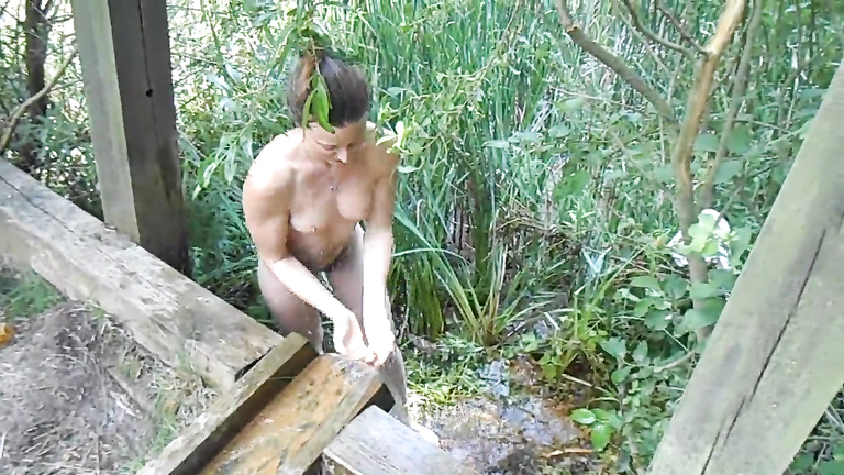 My fit naked girlfriend washes her hot body outdoors